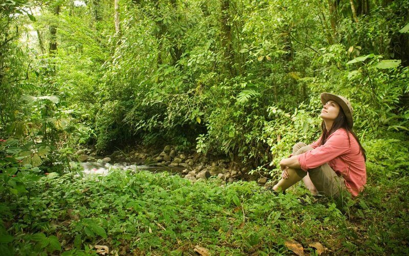 Women sat by stream in Nature