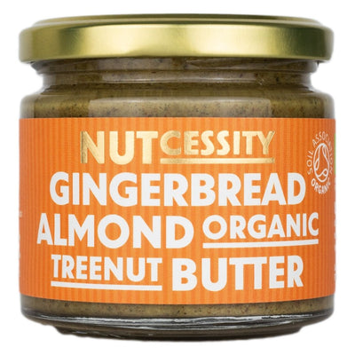 Nutcessity's Organic Gingerbread Almond Butter. Made with no added sugar or oil. Photo on orange background.