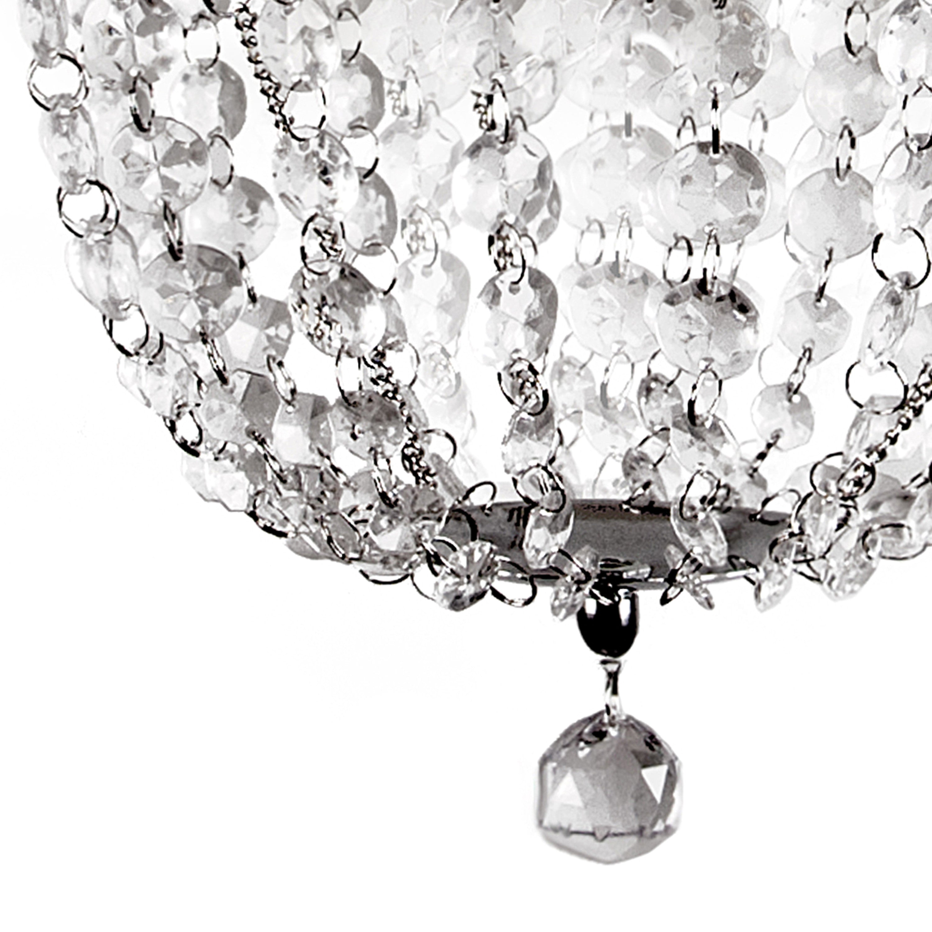glimmers light unique interiors of pin pendant tiers crystal for s glass this elegant lighting a today look modern with sophisticated and globe chandelier