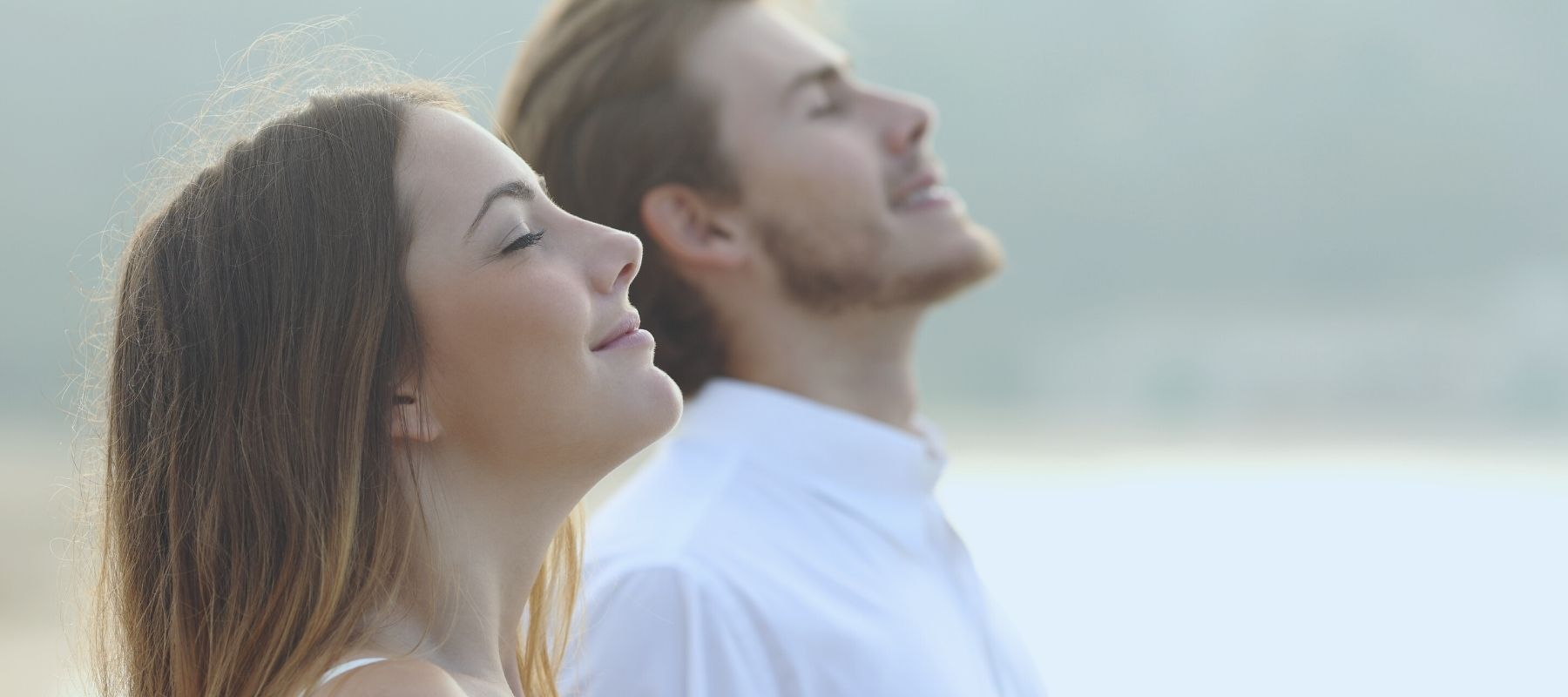 Man and woman breathing in fresh air together