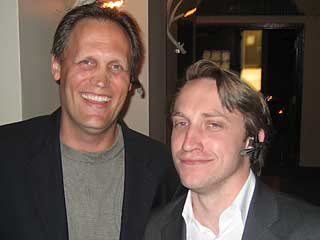 Chad Hurley (right) with Boris Seibert wearing the Plantronics Voyager 510