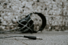 3.5mm jack with headphones in the background
