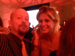 Rachel Hunter with Mike Faith wearing the Plantronics 665 Bluetooth headset