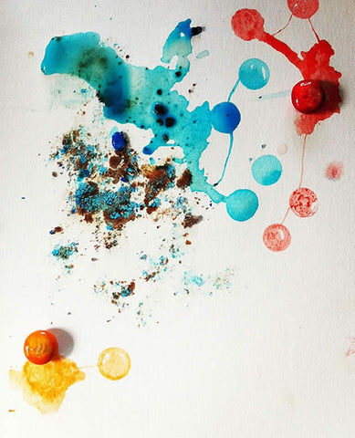 The brightly coloured food dye from M&Ms has been used as a painting medium in this example, with the chocolate candy photographed in place (photography is a good option when using mediums that might erode or decay over time).