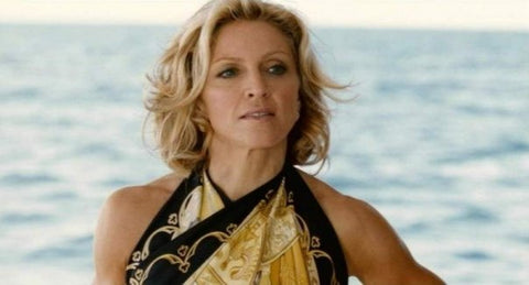 Madonna was seen wearing a Hermes scarf in place of top in the movie