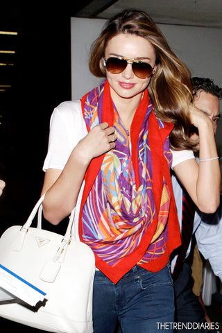 Miranda Kerr perks up the look by wearing a bright Hermes scarf