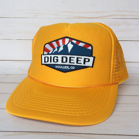 Yellow trucker hat with color dig deep logo patch