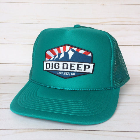 Jade green trucker hat with color dig deep logo patch