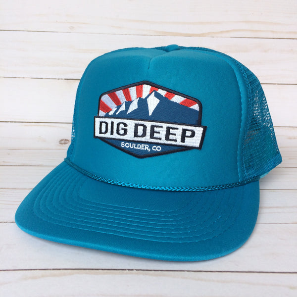 Turquoise trucker hat with color dig deep logo patch