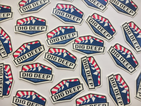 Dig Deep Logo sticker with blue mountains and red sunbeams