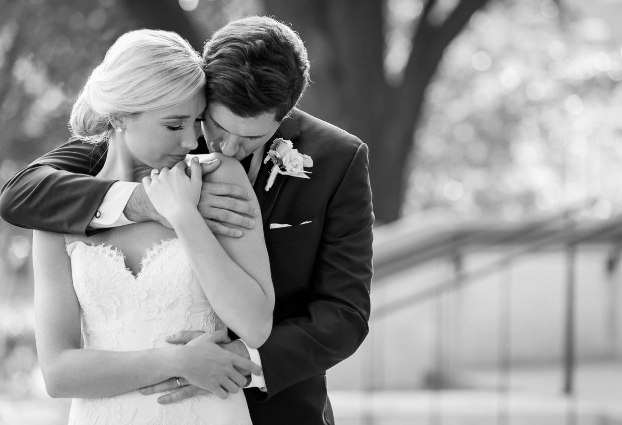 A black and white capture of bride and groom by Tracy Autem