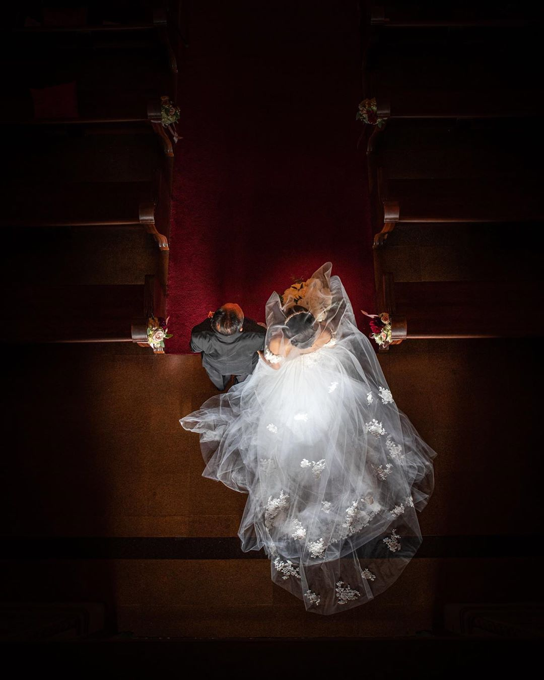 Aerial shot of a bride walking down the aisle with her father