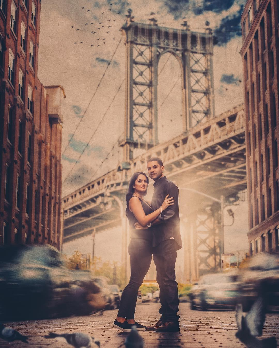 couple standing facing camera in new york city lower east side by bridge