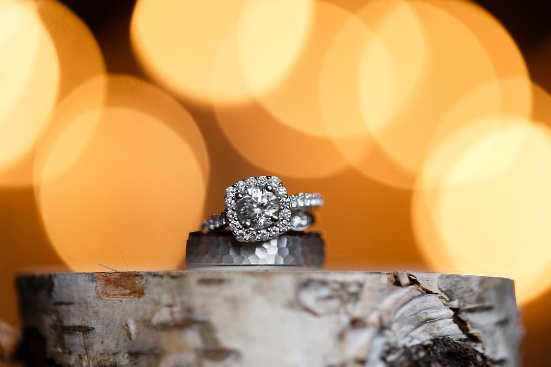 Close up shot of a diamond ring with yellow bokeh background