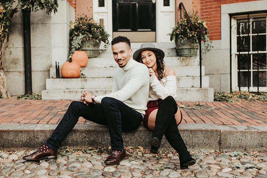 Couples posing for an engagement session