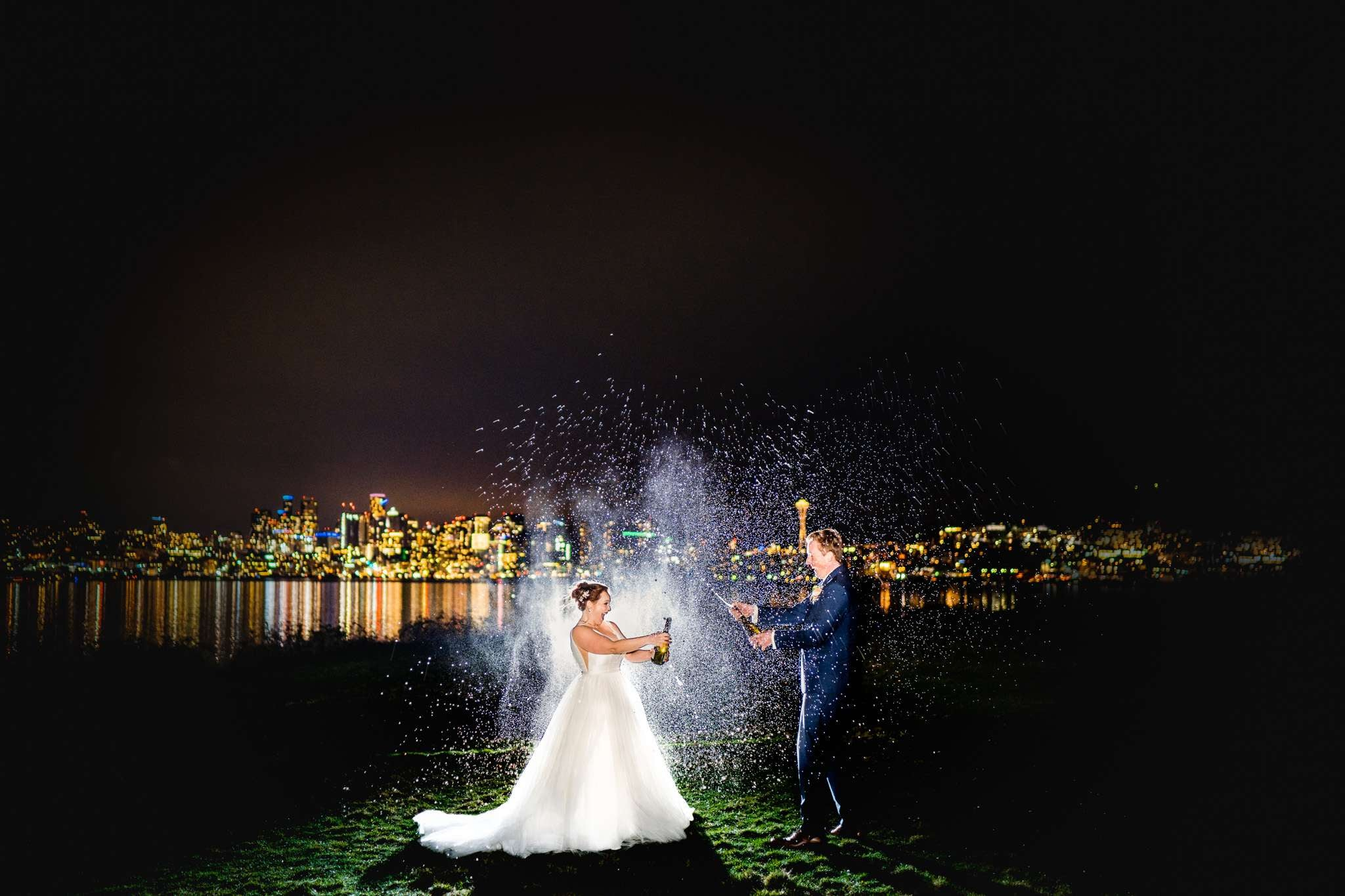 Bride and groom popping open the bottles of champagne