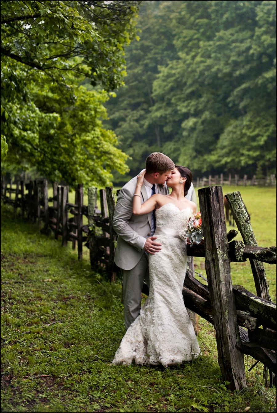 Bride and groom posing for a kiss - An image by Blume Photography