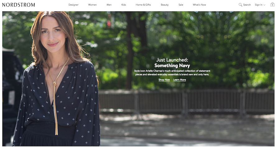 A screenshot of Nordstrom's homepage with a girl wearing a blue top with a long gold necklace.