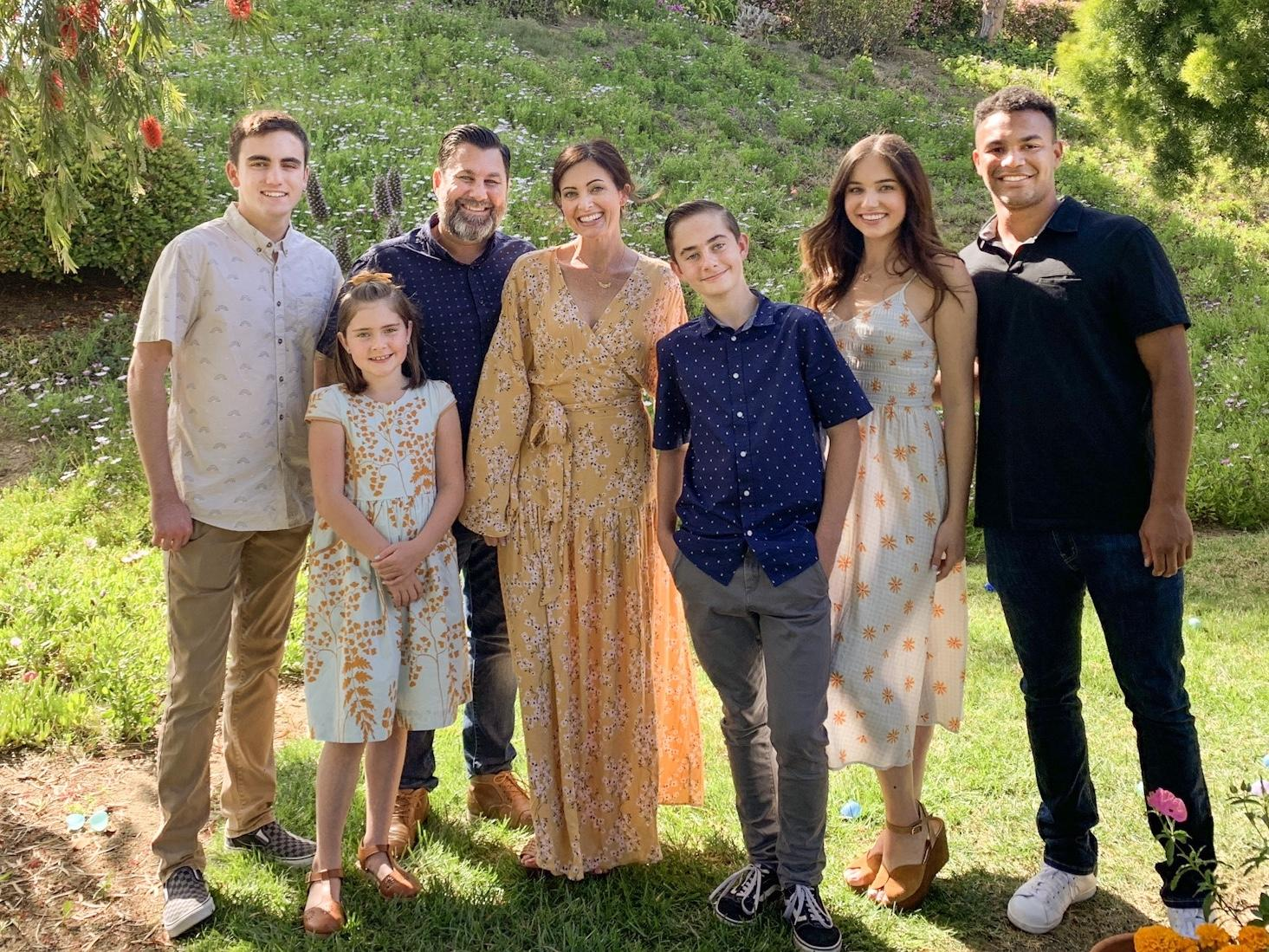 Garrett Delph - the Founder & CEO of ShootDotEdit - with his wife and four children