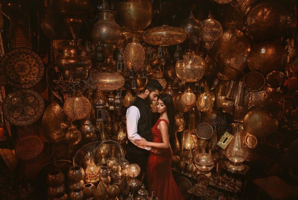 A couple posing for a perfect shot around lanterns