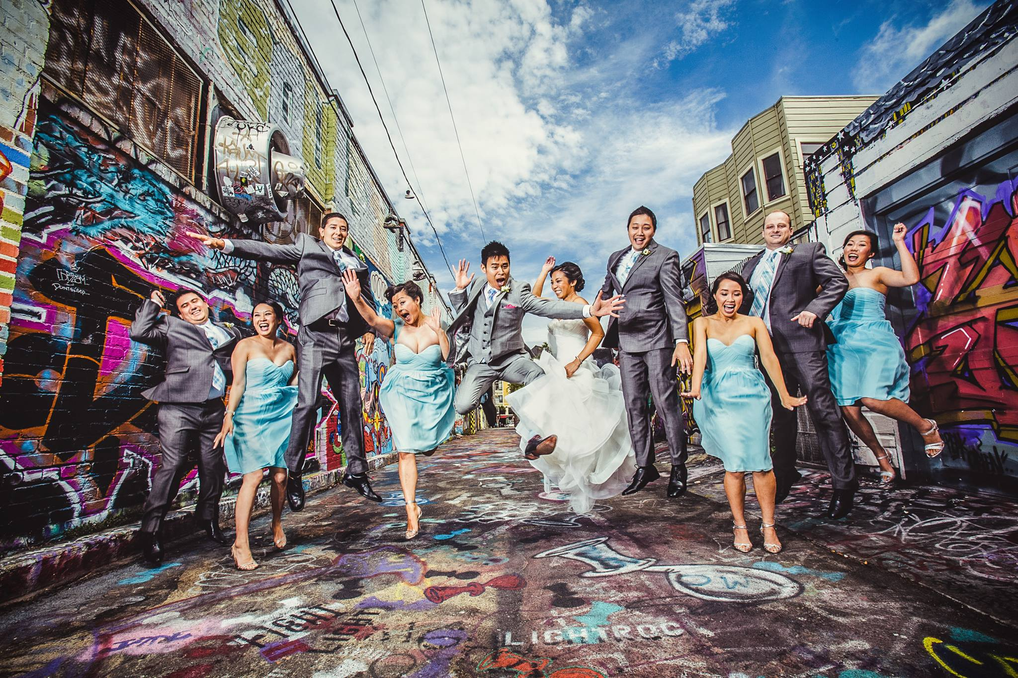 A jumpshot of bride and groom along with the bridesmaids and groomsmen