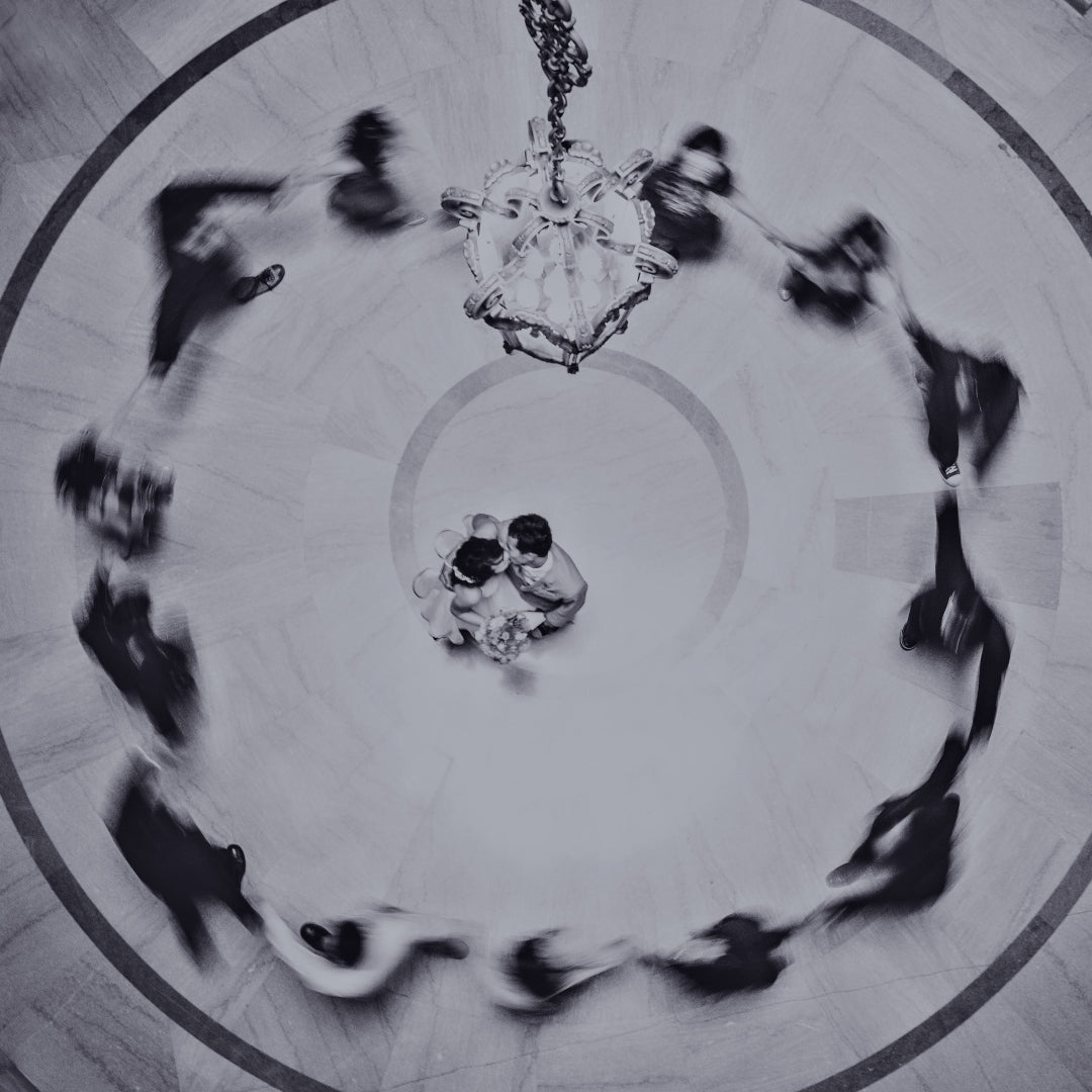 Aerial shot of a couple's first dance as the guests surround them in a circle