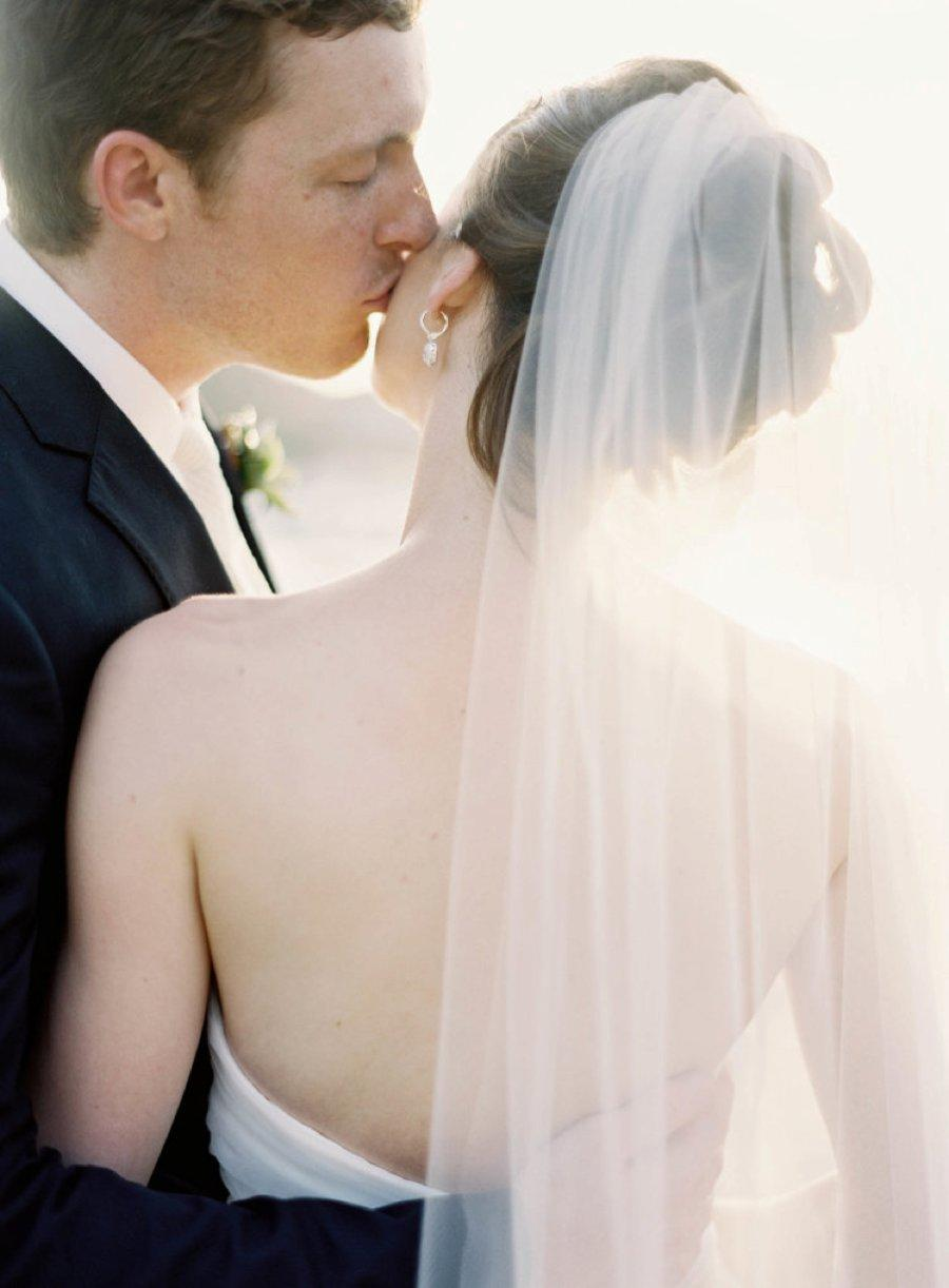 A groom kissing the bride on the cheeks - Jen Huang work on the SDE feature on being an introvert in the photography industry