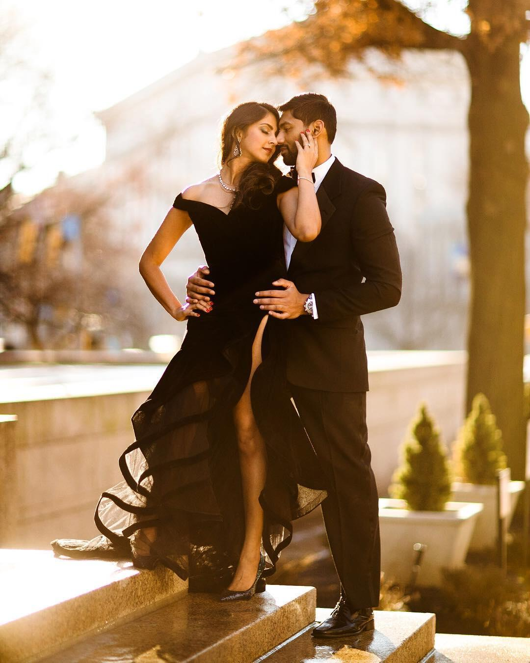 couple in black formal wear standing close