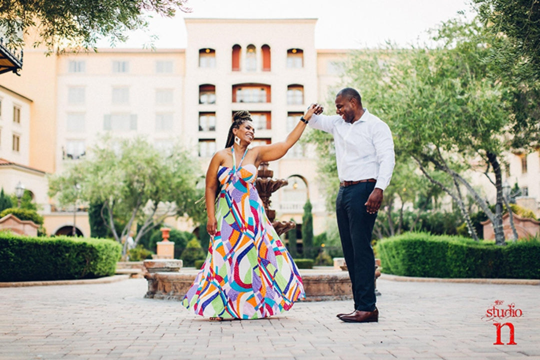 A couple of color posing for an engagement session photographed by husband and wife photographers