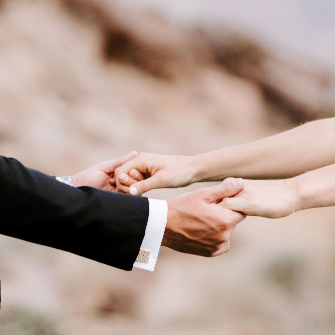 A close up shot of couples holding hands