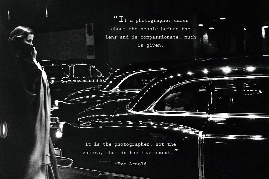 An Eve Arnold quote about photography on a black and white photograph of a woman in a jacket covering her face and standing on the curb while cars pass on the street.