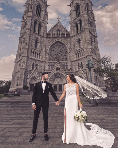 gothic cathedral with bride and groom holding hands in front