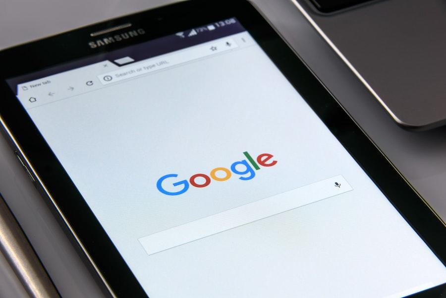 A tablet with a browser open to the Google homepage.