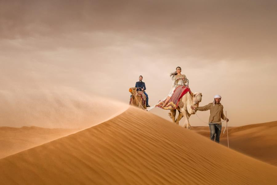 Amazing capture by Sanjay Jogia of a couple on a desert safari - Making for a great photograph for print competitions