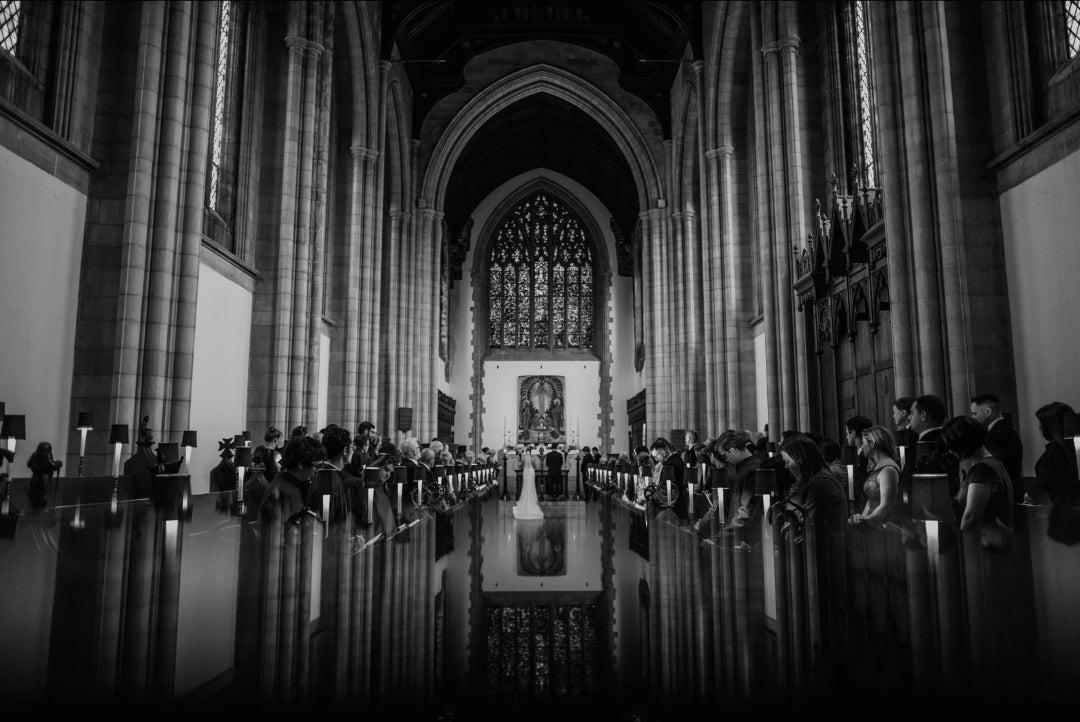 Black and white ceremony picture taken from behind the congregation