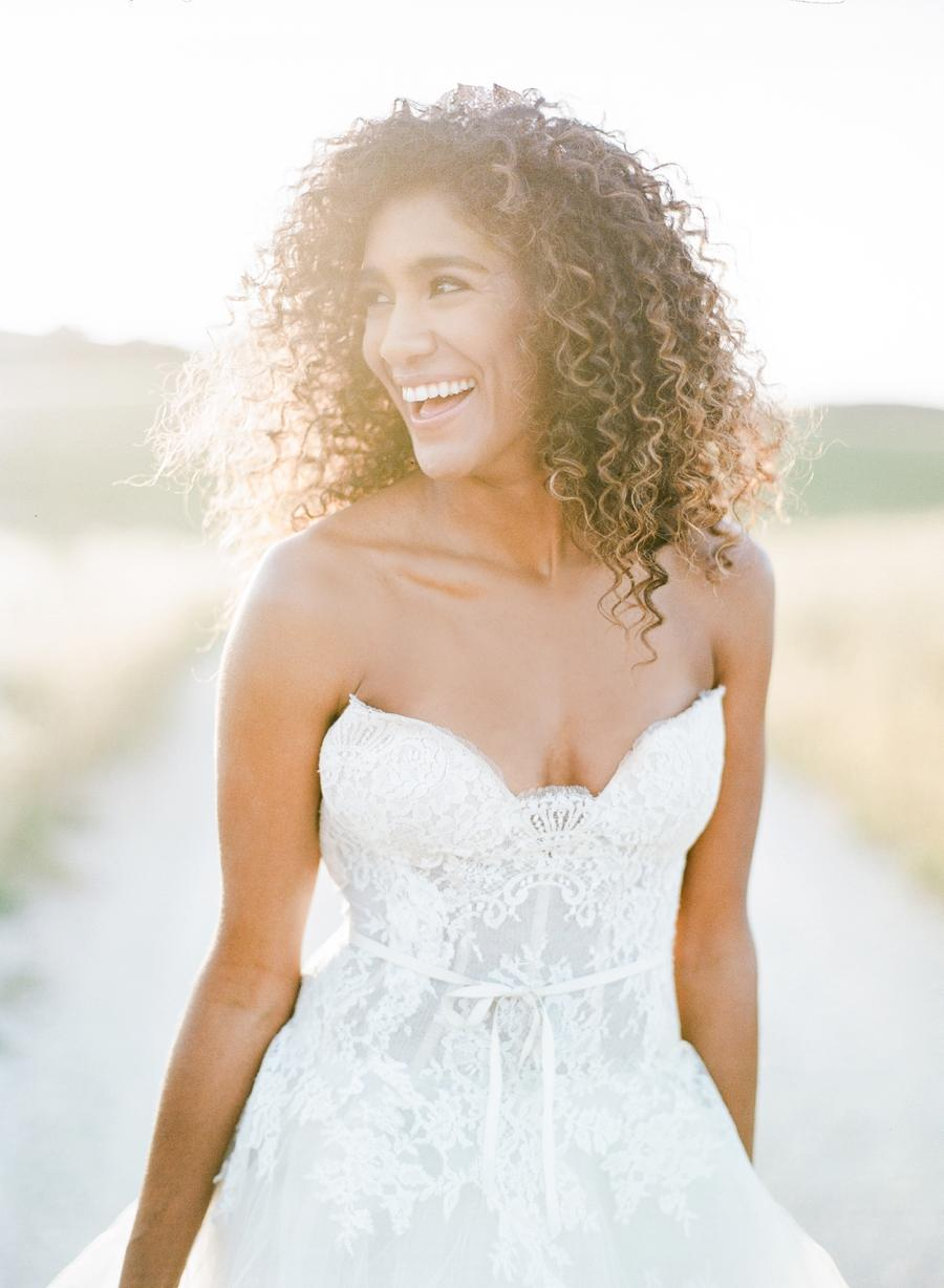 A bride smiling for a perfect portrait during golden hour
