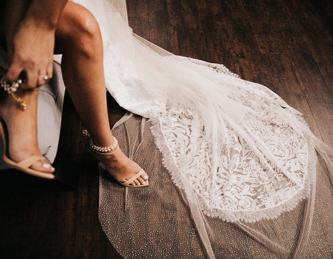 Close up shot of a bride wearing her wedding day shoes
