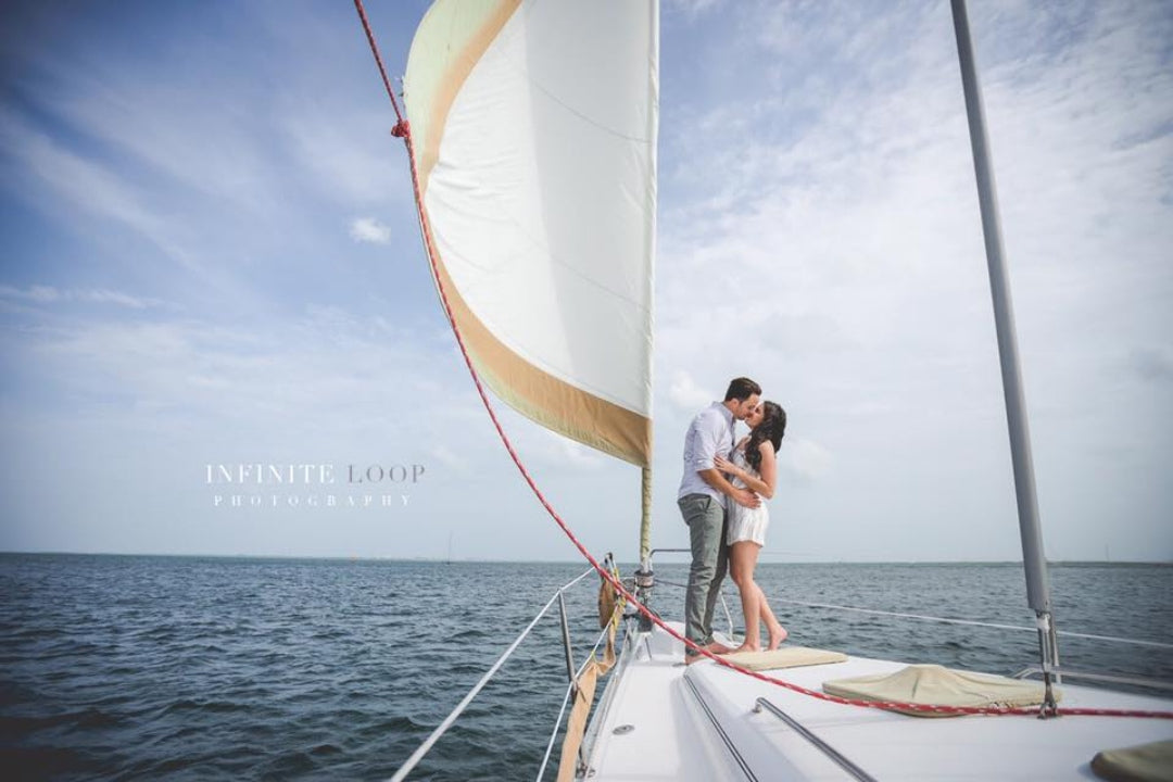A couple posing on a yatch during an engagement session
