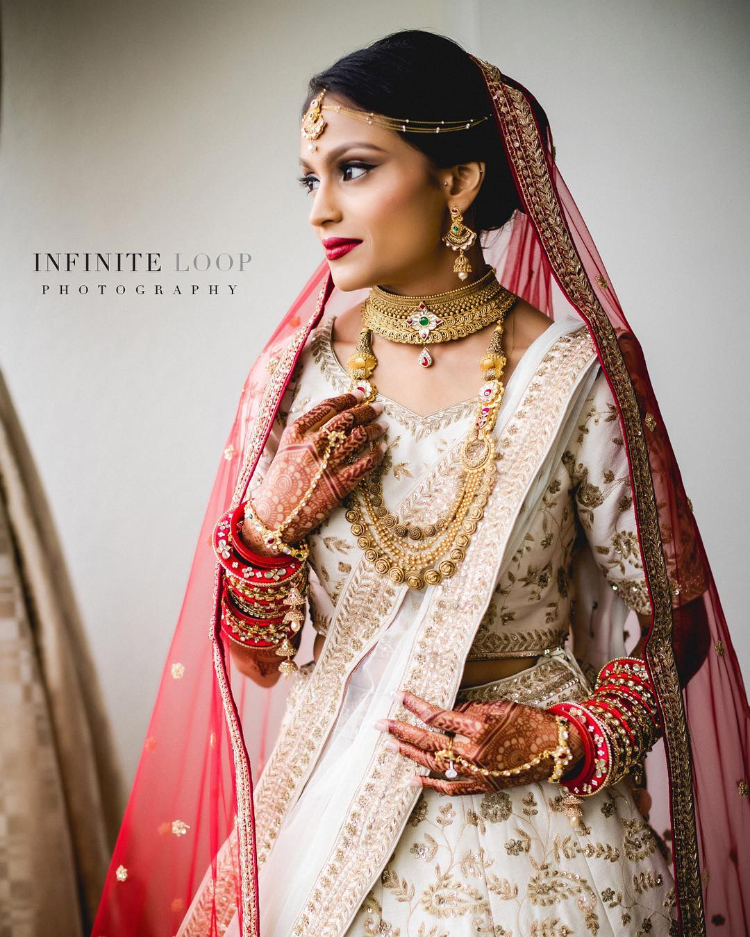 A portrait of a bride dressed in Indian wedding dress