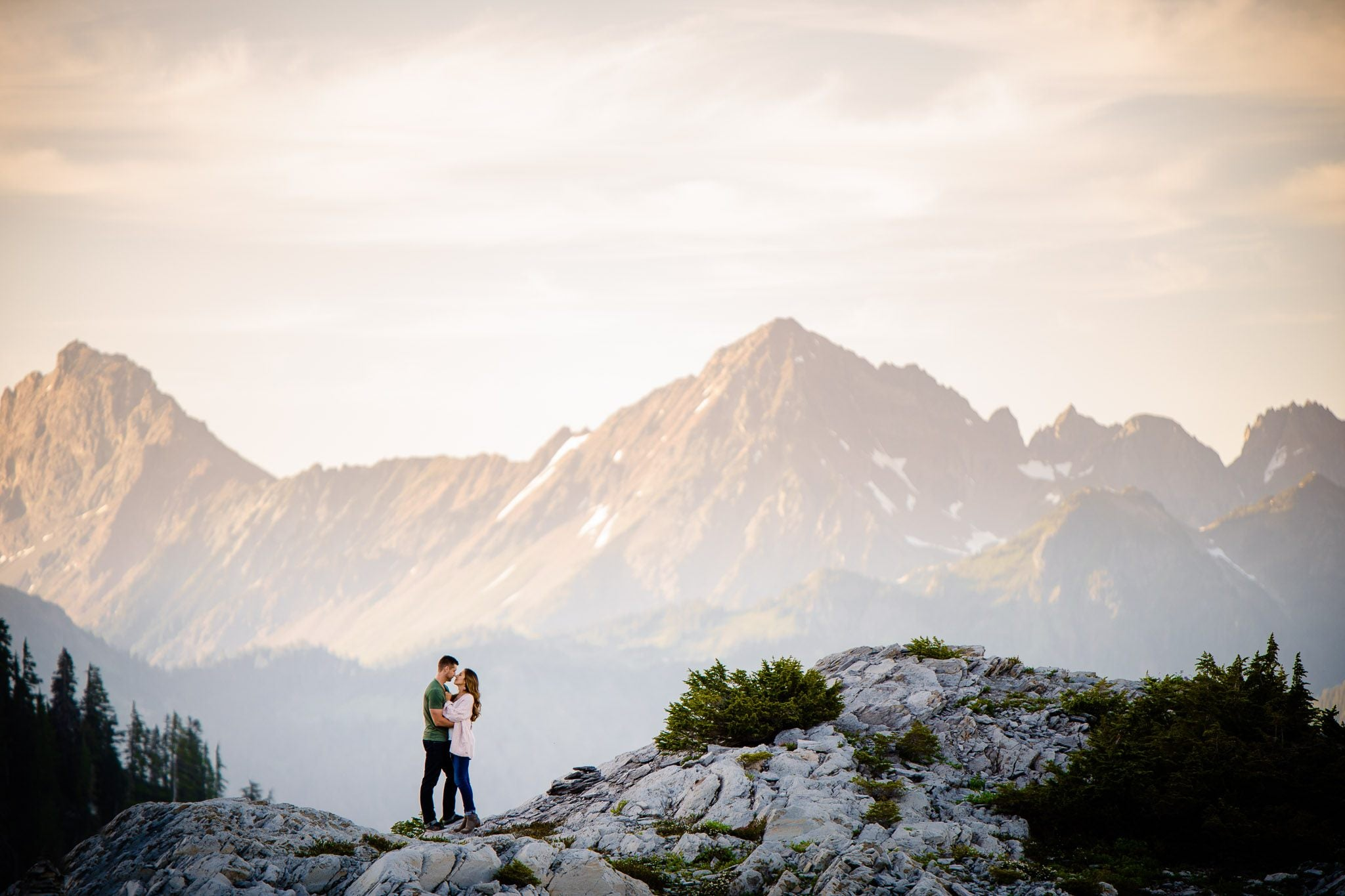 Couples posing on top of a cliff - one of the captures by Joe and Darryl Ann (a husband and wife team) of Salt and Pine Photo