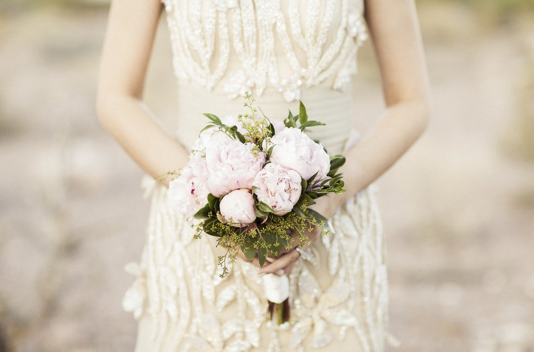 Mid closeup shot of a bride holding bridal bouquet in her hands