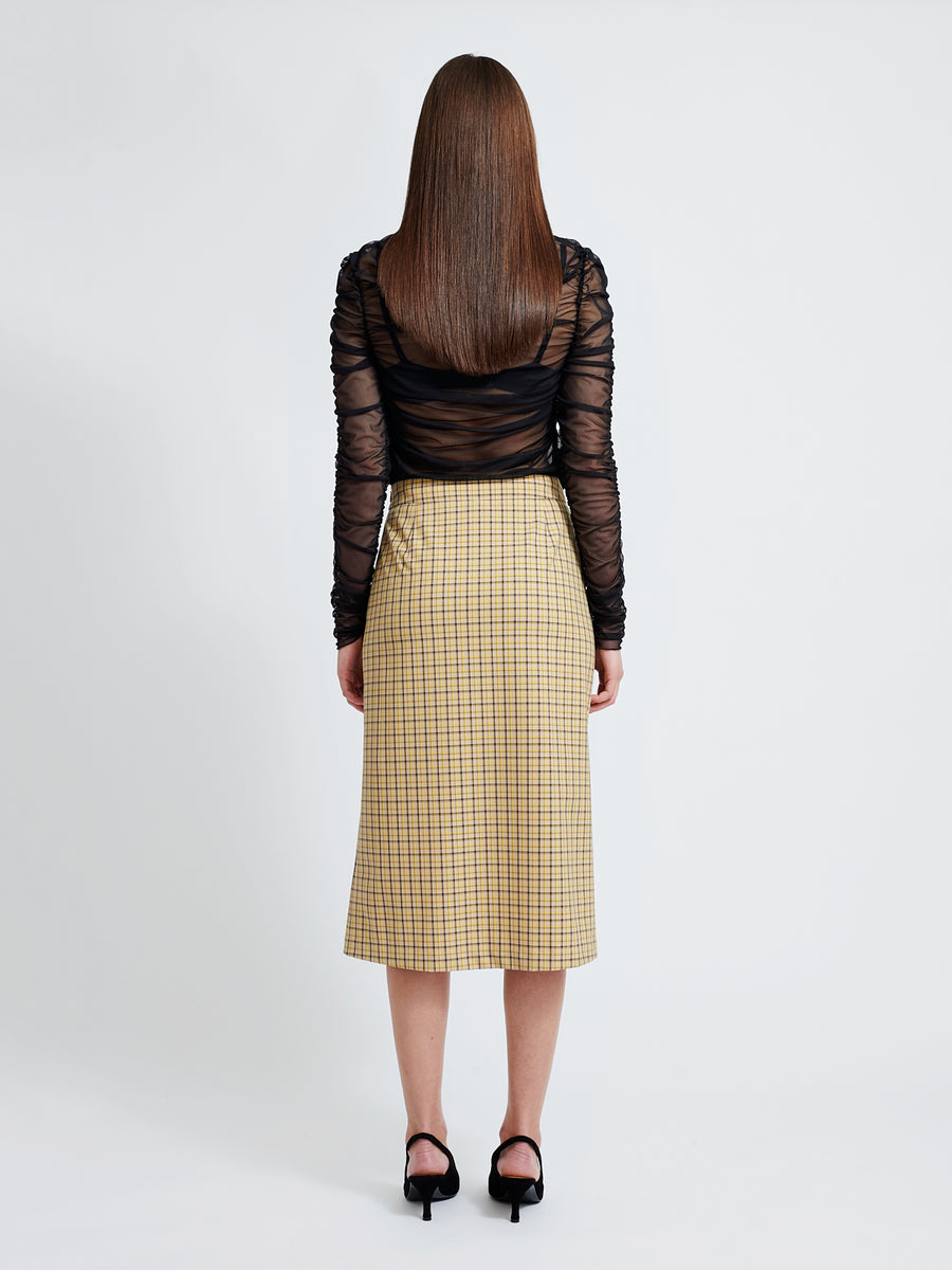 Clem skirt is a straight, fitted wrap skirt made of a checked leftover fabric