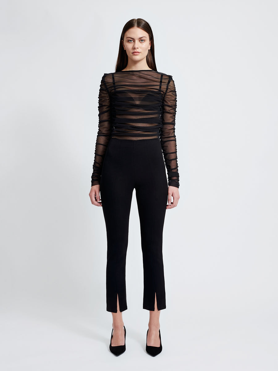The Leah pants are high waisted and slightly cropped, with a hidden zipper on the side
