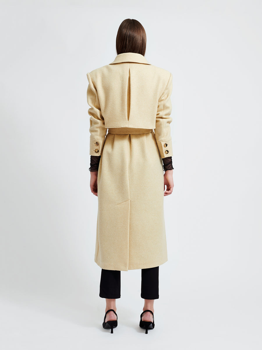 The Victoire coat is a straight fitted long coat