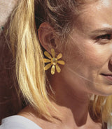 Margaritas earrings from the Ajuar collection of the Après Ski brand.