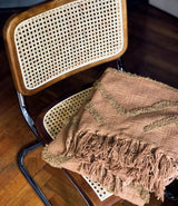 Brown fringed throw by HK Living.