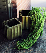 Green Embossed Planter by Serax, available in two sizes.