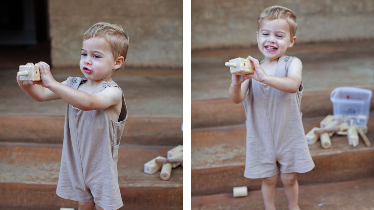 boy with wooden toy
