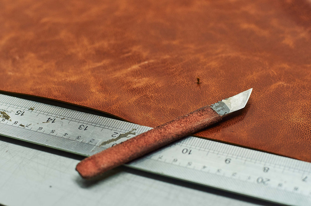 OSTAWLD Leather Manufactory . Stillife . Worktable with Leather and Knife
