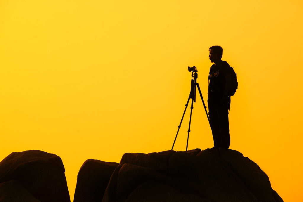 Man standing on rock formation by Zukiman Mohamad   Pexels